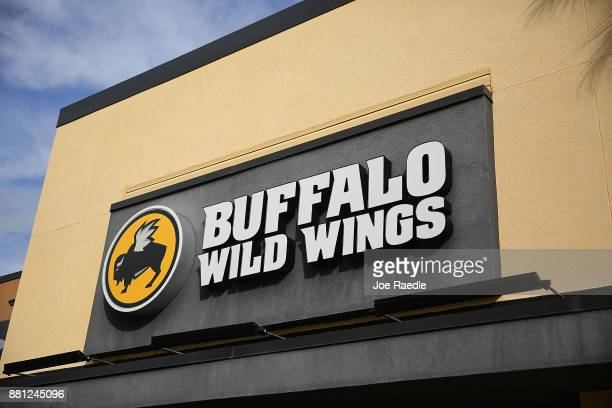 A sign is seen on a Buffalo Wild Wings restaurant on November 28 2017 in Miami Florida Today Arby's Restaurant Group announced it reached a deal to...
