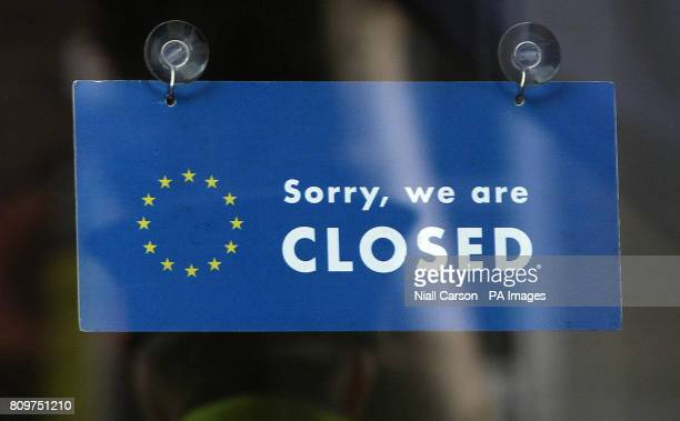A sign is seen on the European Commission headquarters in Dublin as the EU ECB and IMF hold a press conference on the progress of Irelands Fourth...