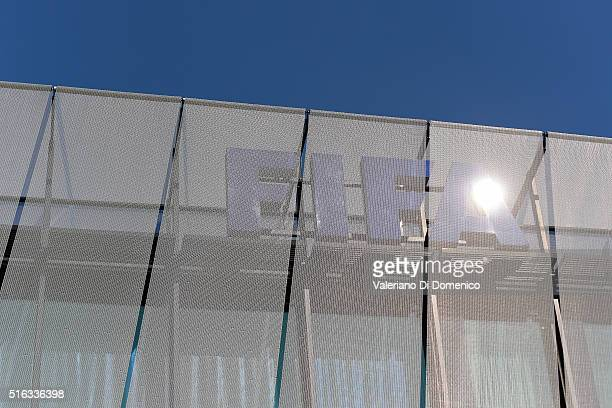 FIFA sign is seen on the top of the headquarters during the FIFA executive committee meeting at Home of FIFA on March 18 2016 in Zurich Switzerland