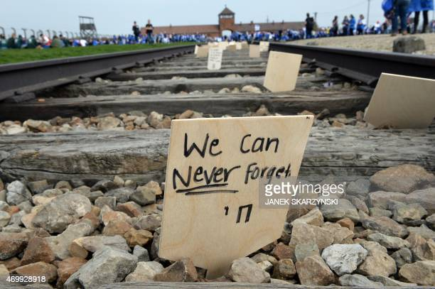 A sign is seen on the tracks at the former Nazi German AuschwitzBirkenau death camp during the 'March of the Living' at in Oswiecim Poland on April...