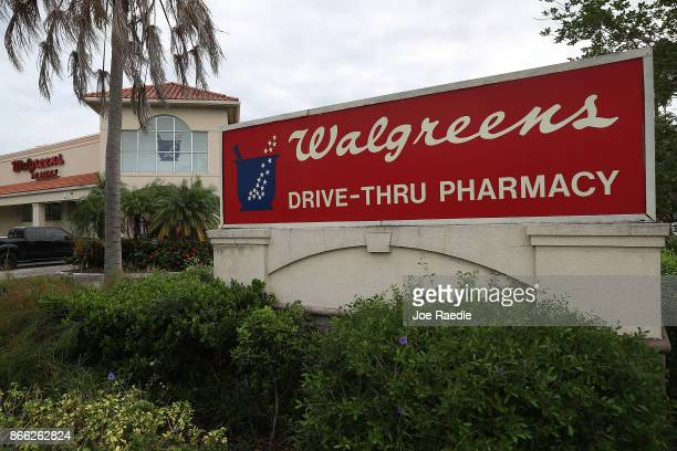 A sign is seen outside a Walgreens store as the company announced it's quarterly profits beat expectations on October 25 2017 in Riviera Beach...