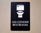 A sign is seen outside the Santee High School's gender neutral restrooms at their campus in Los Angeles California on May 4 2016 There is an...