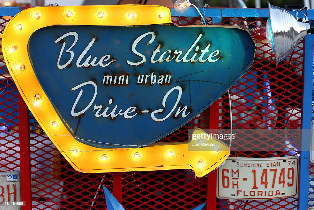 A sign is seen while 'Back to the Future' is to be shown at The Blue Starlite Mini Urban Drive-In on October 11, 2013 in Miami, Florida. Many traditional drive-in theaters around the United States have closed but the owner of The Blue Starlite held a grand opening for his small outdoor facility, which can accommodate 20 to 24 cars and has seats near the front of the viewing area, with hopes it will become popular in the urban core of Miami.