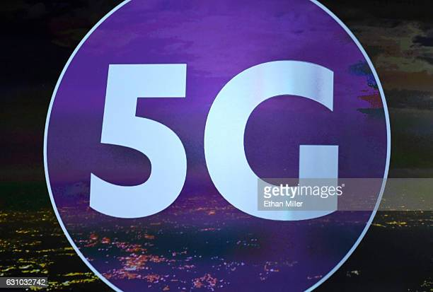 A 5G sign is shown on screen during a keynote address by President and CEO of the Consumer Technology Association Gary Shapiro at CES 2017 at The...