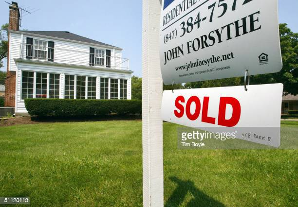 A 'SOLD' sign is visible below a realtor's 'FOR SALE' sign in front of a singlefamily home July 27 2004 in Park Ridge Illinois Sales of existing...