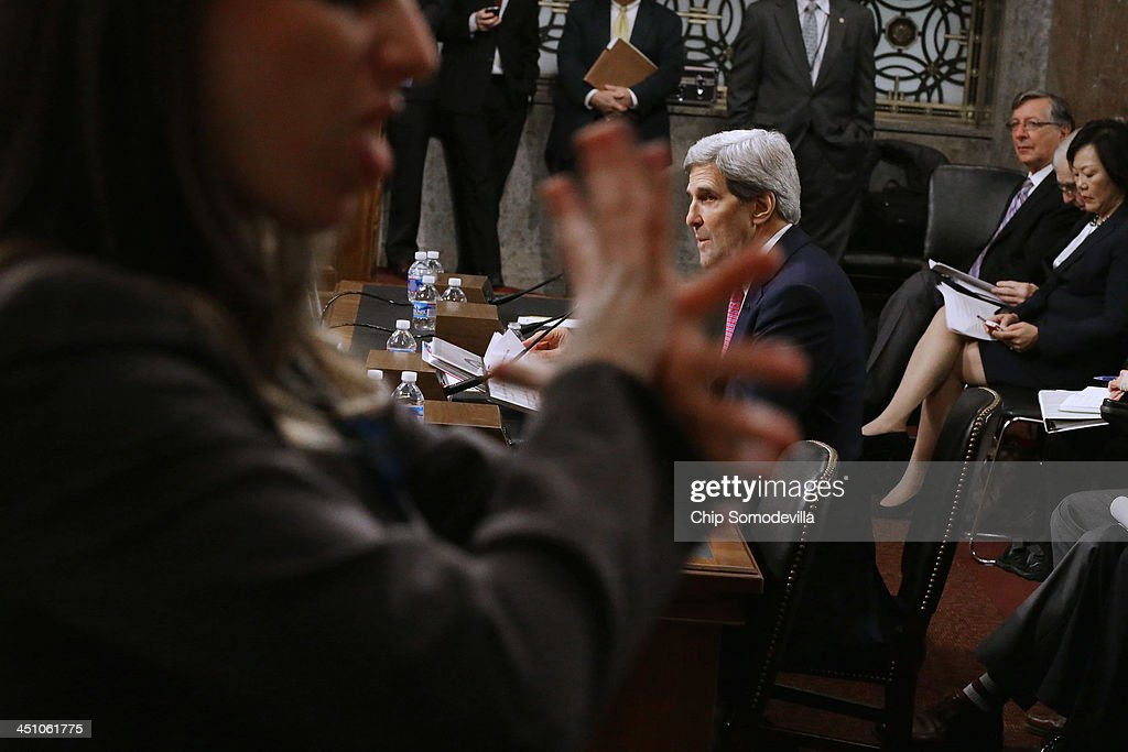 A sign language interpreter signs for the hearing impared as U.S. Secretary of State <a gi-track='captionPersonalityLinkClicked' href=/galleries/search?phrase=John+Kerry&family=editorial&specificpeople=154885 ng-click='$event.stopPropagation()'>John Kerry</a> testifies before the Senate Foreign Relations Committee about the Convention on the Rights of Persons with Disabilities in the Dirksen Senate Office Building on Capitol Hill November 21, 2013 in Washington, DC. Kerry encouraged the committee to vote for adoption of the treaty which he says will bring standards enjoyed by handicapped and disabled people in the United States to the international community.