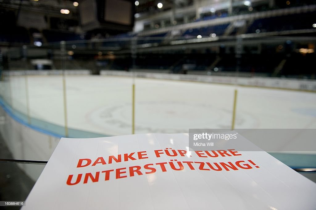 A sign lays next to the pitch after game three of the DEL pre-play-offs between Thomas Sabo Ice Tigers and Grizzly Adams Wolfsburg on March 17, 2013 in Nuremberg, Germany.