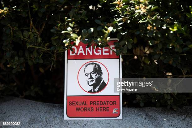 A sign left by a protestor sits outside of the News Corp and Fox News headquarters following a rally against Fox News television personality Bill...