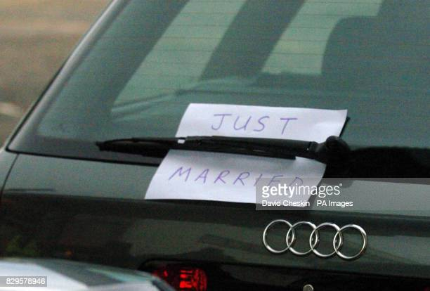 A sign left on the car waiting for the arrival of the Prince of Wales and the Duchess of Cornwall at Aberdeen airport as they make their way to start...
