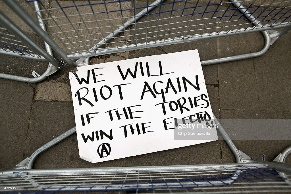 A sign left over from the previous day's anarchist protest promises more violence if there is a Tory win in the general elections May 8 2015 in...
