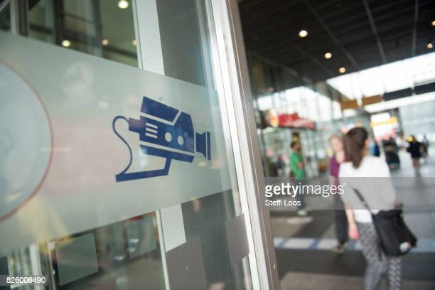 A sign makes passersby aware of a facial recognition technology test at Berlin Suedkreuz station on August 3 2017 in Berlin Germany The technology is...