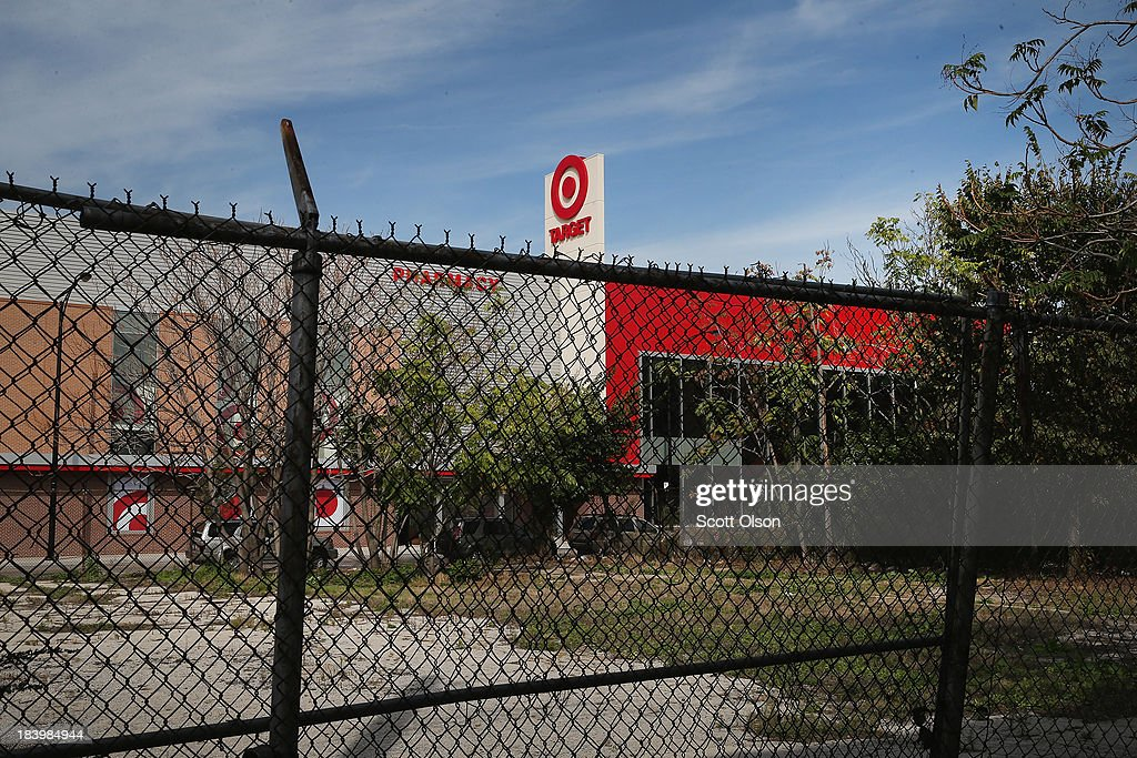 A sign marks a newly-opened Target store on October 10, 2013 in Chicago, Illinois. The store, which opened on October 8, was built on land where the notorious Cabrini-Green housing project once stood. The last of the Cabrini-Green high-rise homes were demolished two years ago. The housing project has been replaced with townhomes and retail shops, with some of the property being left vacant.