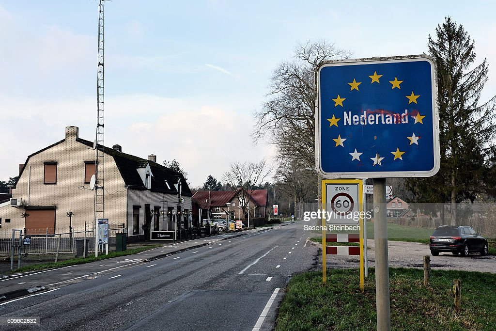 A sign marks entry to Holland at the L373 country road on the German-Dutch border on February 11, 2016 near Elmpt, Germany. Despite an announcement by Dutch authorities two days before that effective immediately police would begin conducting stricter controls of incoming traffic at border crossings to Germany not a single Dutch police officer was present at at least 15 border crossings today. Dutch authorities made the announcement as part of an effort to prevent migrants who have no case for asylum from entering Holland.
