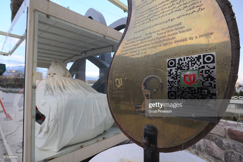 A sign marks the destroyed car wrapped in a symbolic burial shroud of Massoud Alimohammadi an Iranian nuclear scientist assassinated on Jan 12 that...