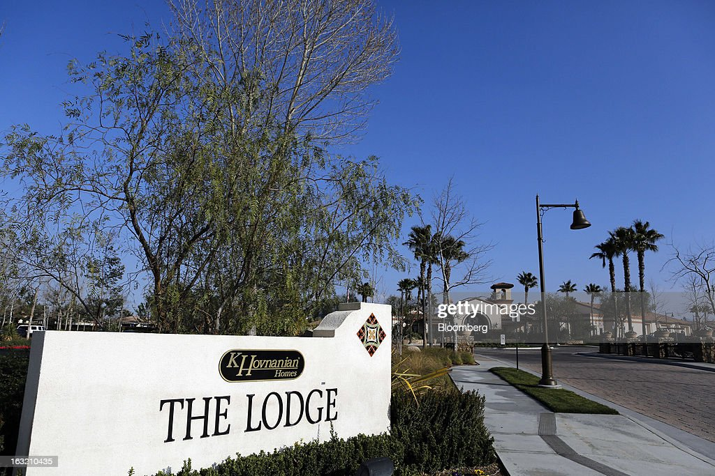 A sign marks the entrance to The Lodge recreation area at the Hovnanian Enterprises Inc.'s Four Seasons housing development in Beaumont, California, U.S., on Monday, March 4, 2013. Hovnanian Enterprises Inc., the best-performing U.S. homebuilder stock in the past 12 months, reported a narrower loss for its fiscal first quarter as sales and orders increased amid a housing rebound. Photographer: Patrick T. Fallon/Bloomberg via Getty Images