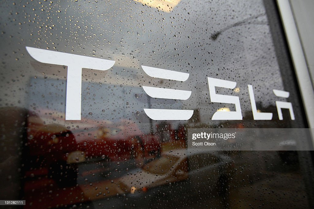 A sign marks the location of a Tesla dealership on November 3, 2011 in Chicago, Illinois. Tesla Motors Inc. stock rose more than 13 percent today after the electric sports car maker reported a less-than-expected third quarter loss. Tesla has already sold out of next year's production of the Model S sedan, the company's first four-door vehicle.