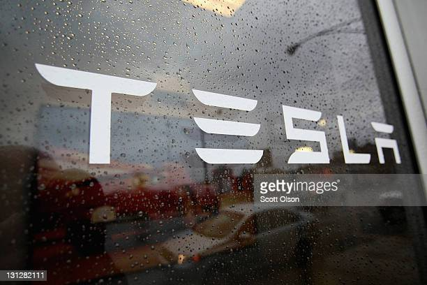 A sign marks the location of a Tesla dealership on November 3 2011 in Chicago Illinois Tesla Motors Inc stock rose more than 13 percent today after...