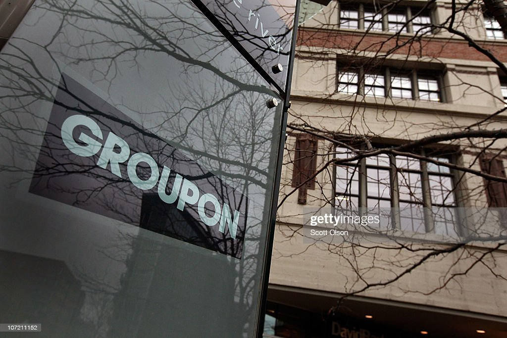 A sign marks the location of the Groupon headquarters on November 30, 2010 in Chicago, Illinois. Rumors are circulating that Google is close to reaching a deal to buy Groupon for a reported $5.3 billion.