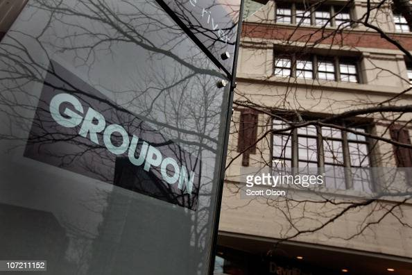 A sign marks the location of the Groupon headquarters on November 30 2010 in Chicago Illinois Rumors are circulating that Google is close to reaching...