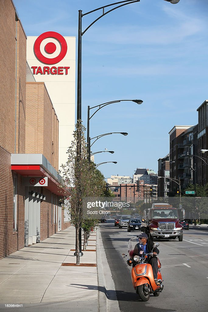 A sign marks the newly-opened Target store on October 10, 2013 in Chicago, Illinois. The store, which opened on October 8, was built on land where the notorious Cabrini-Green housing project once stood. The last of the Cabrini-Green high-rise homes were demolished two years ago. The housing project has been replaced with townhomes and retail shops, with some of the property being left vacant.