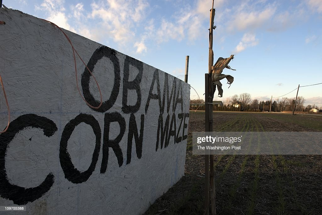 A sign, mocking President Obama, is displayed in a corn field outside Old Fort, Ohio on January 17. The field is near the Arm and Hammer factory where Cathy Morris and Bill Herr work. Morris is a supporter of the President. Herr is concerned about the direction of the country.