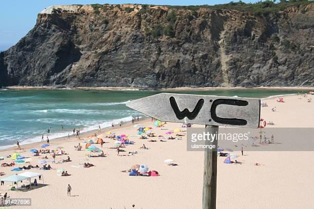 WC sign near beach