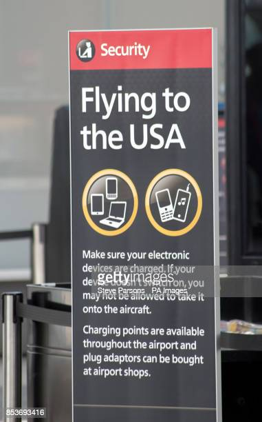 A sign near security in Terminal 5 of Heathrow Airport informing passengers about new restrictions on traveling to the USA