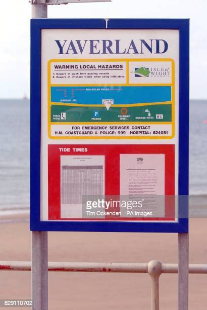 Sign near the beach at Yaverland near Sandown on the Isle of Wight where a two year boy died was killed when a car plunged 12 feet from a car park on...
