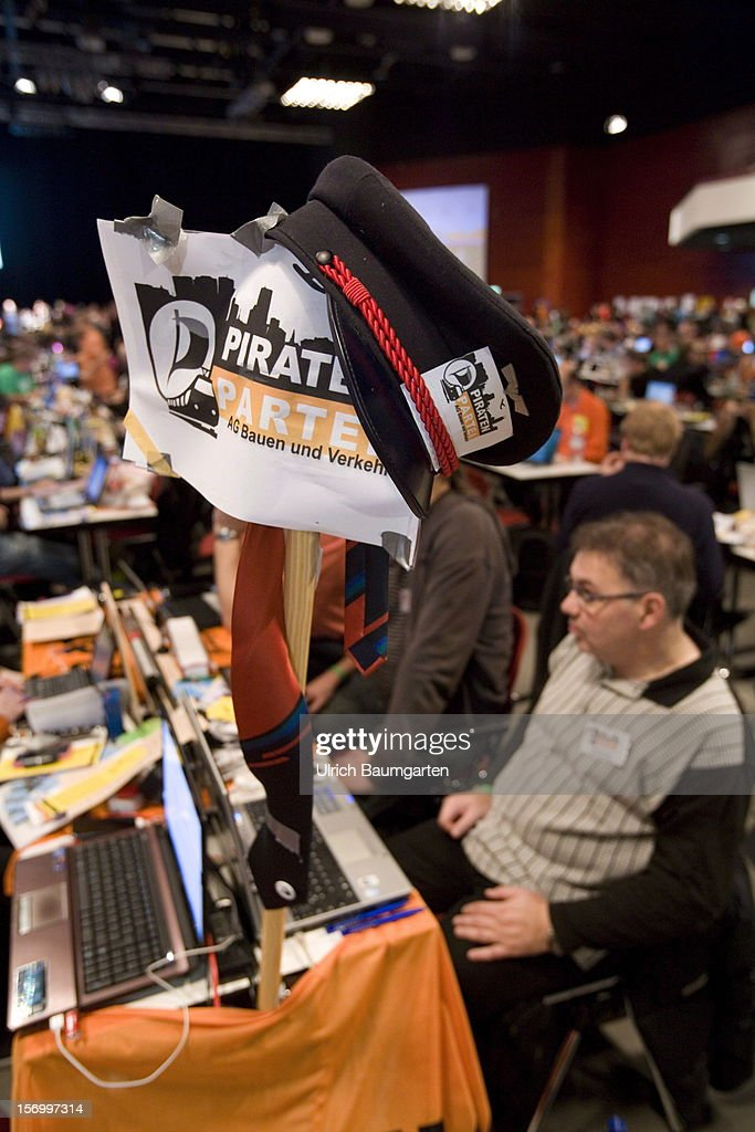 Sign next to a table at the Pirate Party National Convention at RuhrCongress on November 24, 2012 in Bochum, Germany. German Pirates have a lot to achieve as the party is flagging in the polls and facing national elections in less than a year.