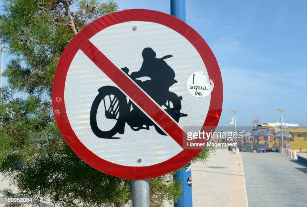 A sign no motorbikes is seen at the entrance to the harbor of Ayia Napa on May 22 2013 in Ayia Napya Cyprus