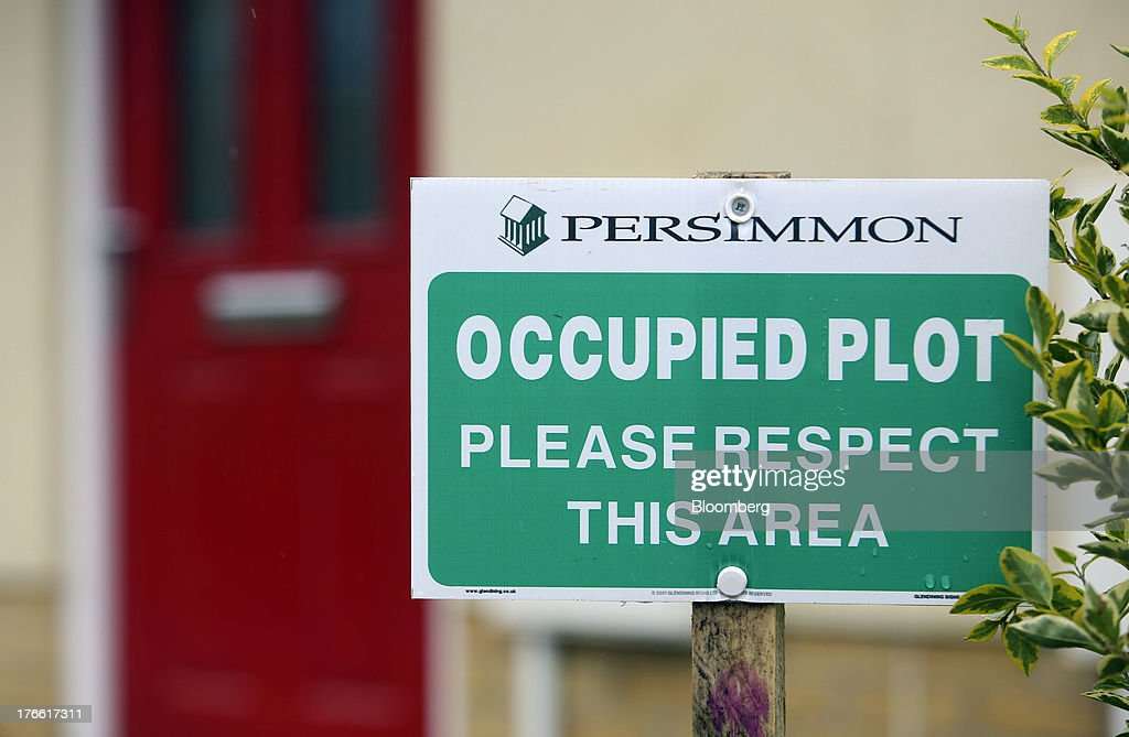 A sign notifies visitors that a newly constructed house is occupied at a Persimmon Plc residential building site in Romford, U.K., on Friday, Aug. 16, 2013. Persimmon, the largest homebuilder by market value, said in July that its operating margin widened to about 15 percent during the half from 12.1 percent. Photographer: Chris Ratcliffe/Bloomberg via Getty Images