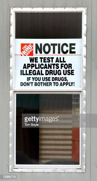 A sign noting drug testing for job applicants is seen in a window near a new Home Depot store November 8 2002 in Niles Illinois Founded in 1978 The...