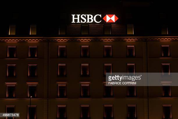 A sign of banking giant HSBC is on the top of a branch on late December 2 2015 in Geneva AFP PHOTO / FABRICE COFFRINI / AFP / FABRICE COFFRINI