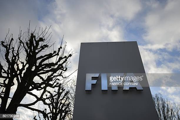 A sign of FIFA is seen at the football's World governing body headquarters on December 17 2015 in Zurich Suspended FIFA president Sepp Blatter...