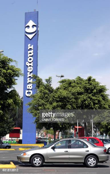 A sign of one of the French supermarkets Carrefour in Mexico City is seen on an avenue 08 February 2005 The world number two of the distribution the...