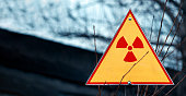 Sign of radiation hazard against radioactive waste, picture with a place for your text, copy space, your text here.