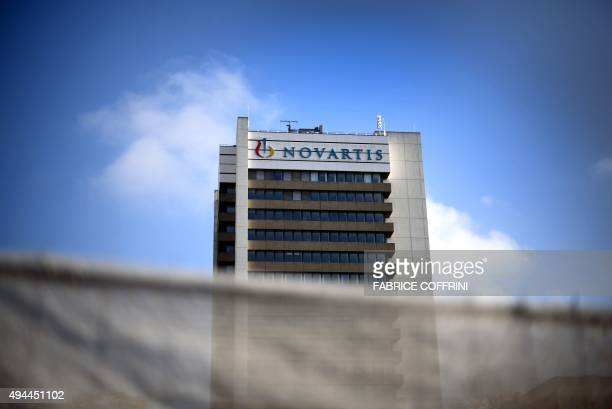 A sign of Swiss pharmaceutical giant Novartis is seen on a building at the company's campus on October 27 2015 in Basel Novartis said that its...