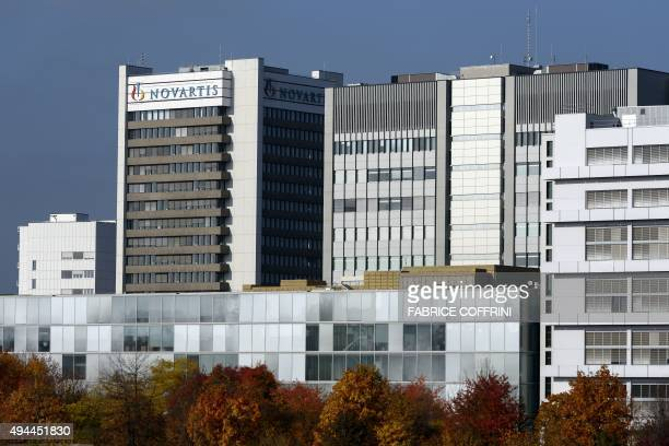 A sign of Swiss pharmaceutical giant Novartis is seen on the top of a building at the company's campus on October 27 2015 in Basel Novartis said that...