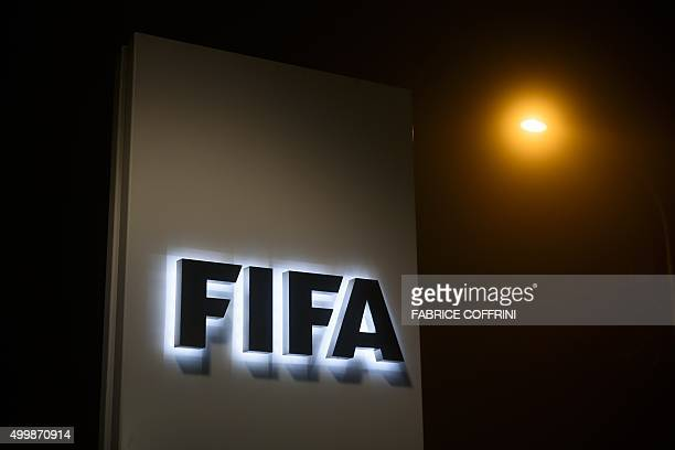 A sign of the FIFA is seen at the entrance of its headquarters on December 3 2015 in Zurich The multimillion dollar corruption scandal engulfing FIFA...