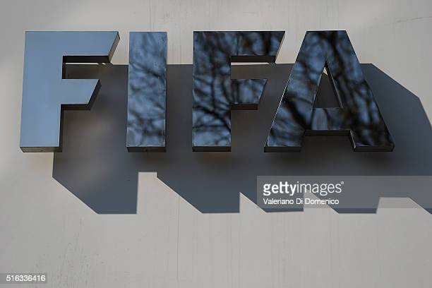A sign of the FIFA is seen at the entrance of its headquarters on March 18 2016 in Zurich Switzerland