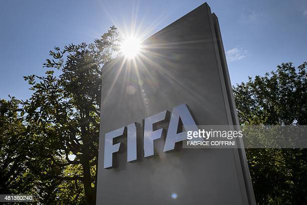 A sign of the FIFA is seen at the entrance of the football's world body on July 20 2015 in Zurich FIFA leaders met July 20 to decide a date for an...