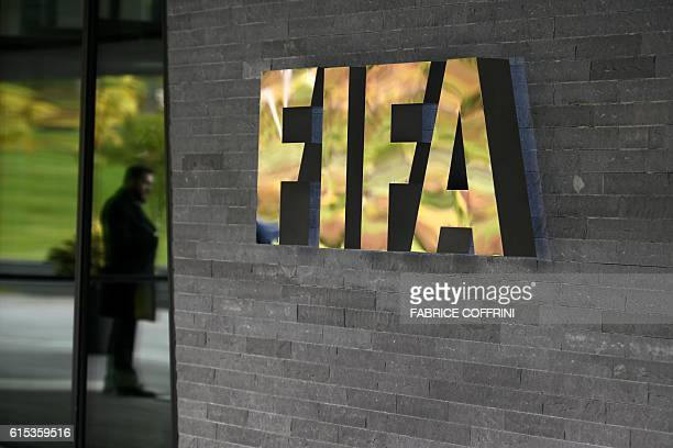 A sign of the FIFA is seen at the entrance of the world football's governing body headquarters on October 13 2016 in Zurich / AFP / FABRICE COFFRINI