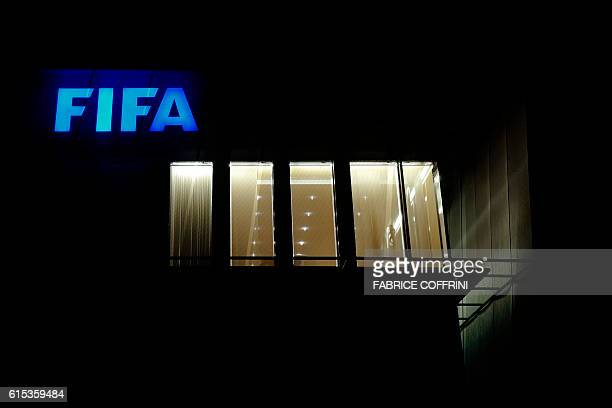 A sign of the FIFA is seen at the top of the world football's governing body headquarters on October 13 2016 in Zurich / AFP / FABRICE COFFRINI