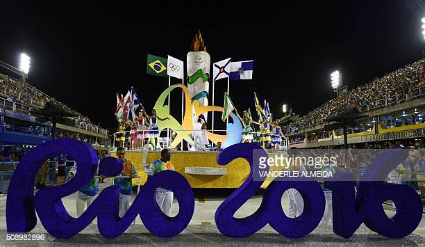 A sign of the Rio 2016 Olympic is seen in front of dancers during the opening ceremony on the first day of parades at the Sambadrome in Rio de...
