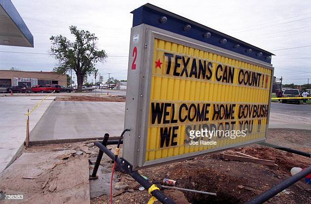 A sign offers support for Republican Gov George W Bush November 15 2000 on the main street in Crawford Texas where Bush has been secluded for most of...