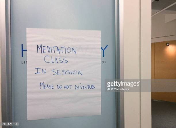 A sign on a door announces a meditation class in session at a financial company on September 21 2017 in New York Loved by millions around the world...