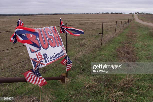 A sign on a fence near the Bush ranch supports the Republican presidential candidate George W Bush in Crawford Texas November 24 2000