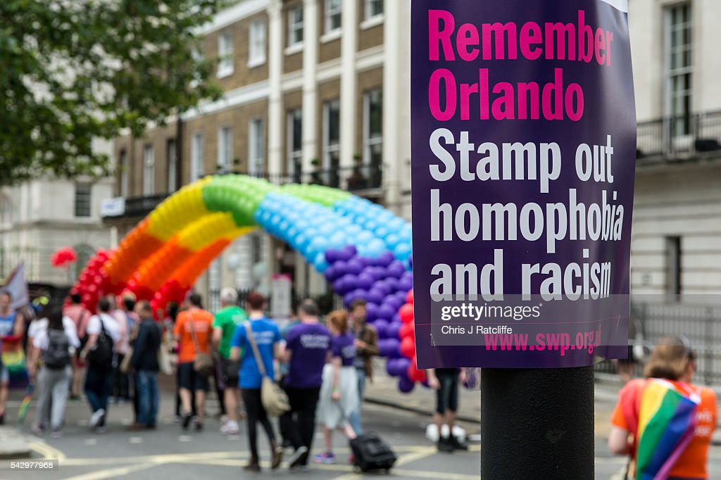 A sign on a lampost next to a rainbow balloon arch as the LGBT community celebrates Pride in London on June 25, 2016 in London, England. Across the city performances and speeches take place as a parade makes it way through the centre ending in Trafalgar Square. 2016 Pride in London comes just two weeks after Omar Mateen shot dead 50 people at Pulse, a gay nightclub in Orlando, Florida.