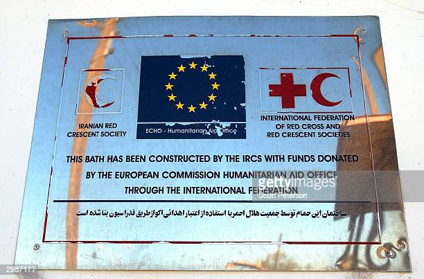 A sign on a portable hygiene unit points to donor cooperation as rebuilding begins on February 15 in Bam Iran after a devastating December 26...