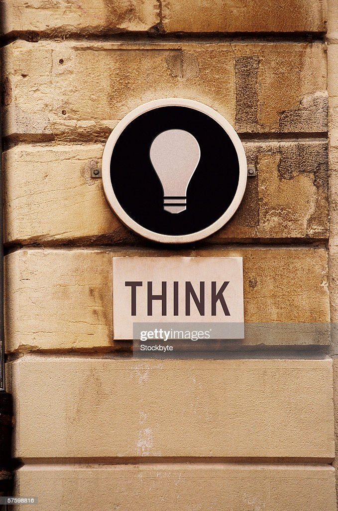 sign on a wall saying think : Stock Photo